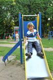 Little boy on a slide Stock Image