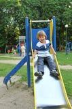 Little boy on a slide stock image