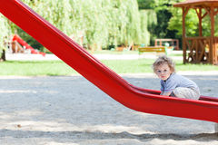 Little boy on slide Stock Image
