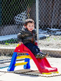 Little boy on slide royalty free stock photos