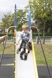 Little boy sliding down a slide Royalty Free Stock Photography