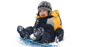 Winter fun. Little boy sliding in the snow Royalty Free Stock Photography