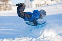 Winter fun - Boy sliding Stock Images
