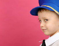 Little boy with a sly look. Stock Photos