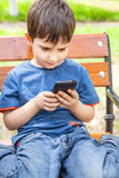 Little boy with smartphone Stock Photos