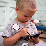 Little boy with smartphone Royalty Free Stock Images