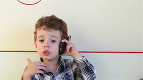 Little boy on the smartphone stock video footage