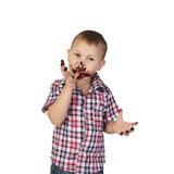 Little boy smeared with chocolate Stock Images