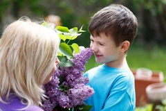 Little boy smell lilac with mother Royalty Free Stock Image