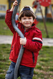 Little boy smile outdoor with pole Royalty Free Stock Photo