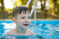 Little boy smile in swimming pool Royalty Free Stock Image