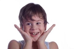 Little boy smiles. The little boy smiles and rejoices simultaneously with it being surprised Stock Photo