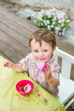Little Boy Smiles at his Pink Easter Egg Stock Image