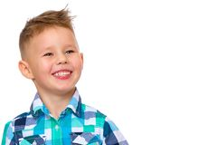 The little boy smiles. Portrait. Smiling little boy, studio portrait on white background. The concept of a happy childhood, well-being in the family. Close-up Royalty Free Stock Photo
