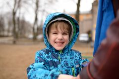 Little boy smiles on street Royalty Free Stock Photography