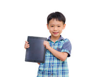 Little boy smiles with tablet computer Stock Images