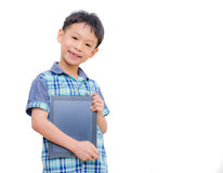 Little boy smiles with tablet computer Stock Photo