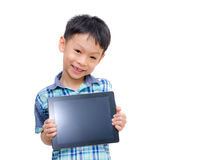 Little boy smiles with tablet computer Royalty Free Stock Photos