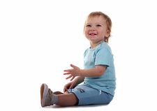 Little boy smiling. Little boy sitting and smiling isolated on the white royalty free stock photography