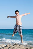 Little boy smiling on beach Royalty Free Stock Image