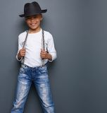 Little boy smiling with black hat and suspenders Stock Photos