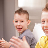 Little boy smiling at camera with his friend Royalty Free Stock Photos
