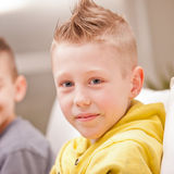 Little boy smiling at camera with his friend Royalty Free Stock Photo