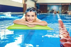 Little boy smiling child smiling at swimming pool indoors.  stock photos