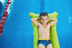 Little boy smiling child smiling at swimming pool indoors.  royalty free stock photo