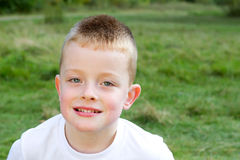 Little boy smiling in the evening Autumn sun Royalty Free Stock Image