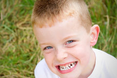 Little boy smiling in the evening Autumn sun Stock Photography