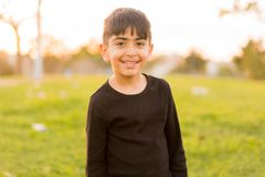 Little boy smiling in the park Stock Images
