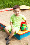 A little boy smiling and playing in the toy car Royalty Free Stock Photography