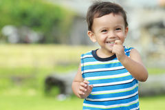 Little boy smiling while running stock photos