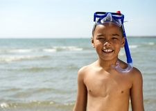 Little boy smiling with snorkel. Close up portrait of a little boy smiling with snorkel at the beach Royalty Free Stock Photos