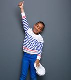 Little boy smiling with thumbs up gesture Stock Image