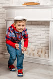 Little boy sneaks. And looking at the camera Royalty Free Stock Photos
