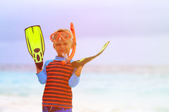 Little boy snorkeling with flippers at beach Stock Images
