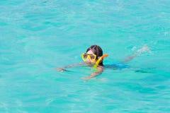 Little boy snorkeling in the ocean Stock Image