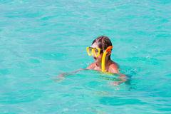 Little boy snorkeling on a tropical beach Stock Photos