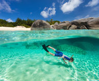 Little boy snorkeling in tropical water Royalty Free Stock Image