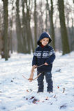 Little boy in the snow with crossbow Royalty Free Stock Photography