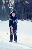 Little boy in the snow with crossbow Royalty Free Stock Image