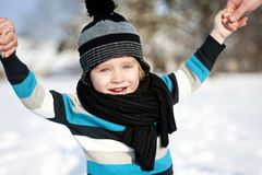 Little boy in the snow. Royalty Free Stock Image
