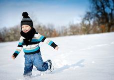 Little boy in the snow. Stock Images