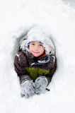 Little boy in a snow fort Stock Image