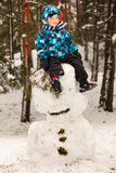 Little boy and snowman Royalty Free Stock Photography