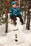 Little boy and snowman Stock Image
