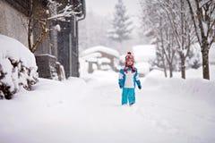 Little boy in a snowsuit walking  Royalty Free Stock Photo