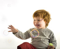 Little boy soap bubbles Stock Photography